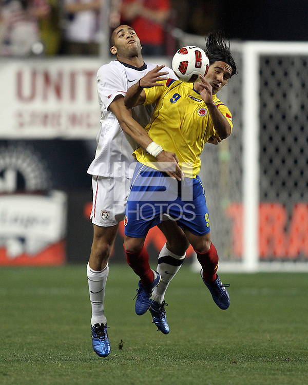 Oguchi Onyewu #5 of the USA MNT crashes into the back of Falcao Garcia #9 of Colombia during an international friendly match at PPL Park, on October 12 2010 in Chester, PA. The game ended in a 0-0 tie.