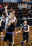 SIOUX FALLS, SD - MARCH 12:  Matt Duniphan #21 from the College of Idaho takes the ball to the basket against Derek Hinen #34 from St. Francis during their semifinal game at the 2018 NAIA DII Men's Basketball Championship at the Sanford Pentagon in Sioux Falls. (Photo by Dave Eggen/Inertia)