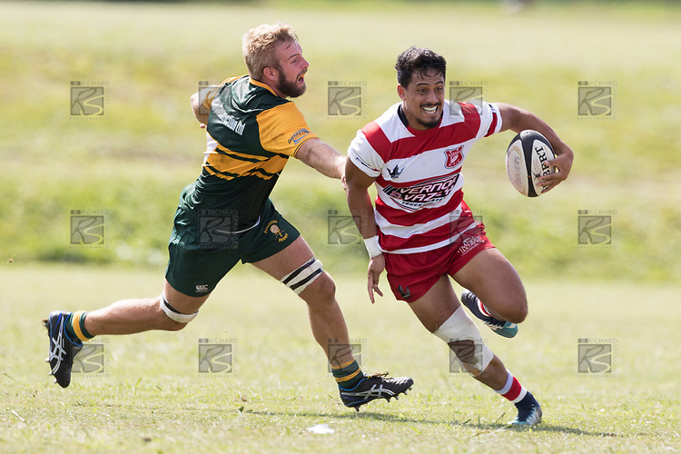 Kalione Hala gets past William Bond. Counties Manukau Premier Counties Power Club Rugby game between Karaka and Pukekohe, played at the Karaka Sports Park on Saturday March 10th 2018. Pukekohe won the game 31 - 27 after trailing 5 - 20 at halftime.<br /> Photo by Richard Spranger.
