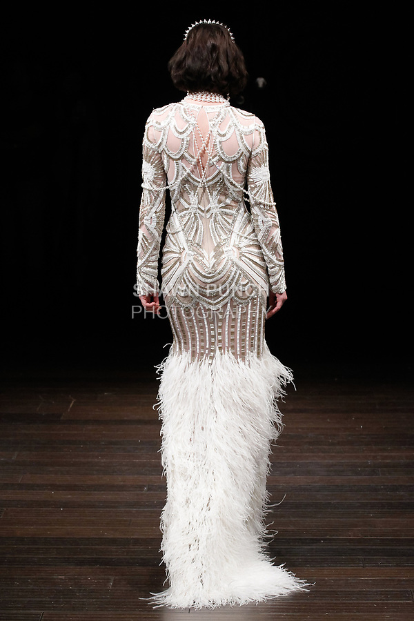 """Model walks runway in a """"Cuba"""" bridal gown from the Naeem Khan Bridal Spring 2018 collection, on April 21, 2017; during New York Bridal Fashion Week."""
