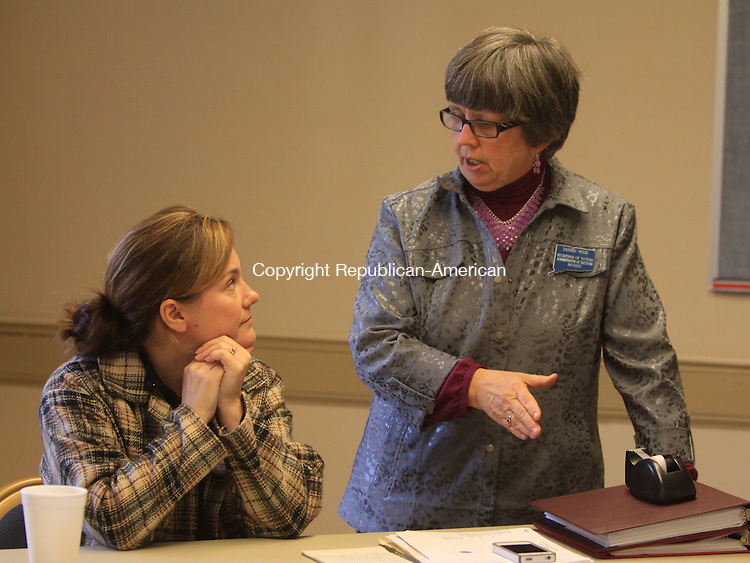 MORRIS, CT - 5 November 2013 - 110513JM03 - Morris Republican Registrar of Voters Denise Weik, right, and Democratic Registrar of Voters Carrie Keppler discuss the voting process at the polling place at Town Hall on Tuesday. John McKenna Photo