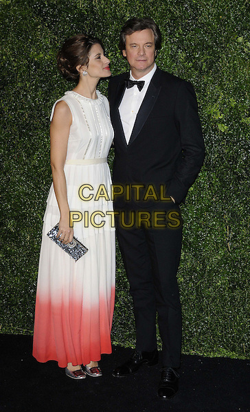 Livia Giuggioli & Colin Firth.The 58th London Evening Standard Theatre Awards in association with Burberry, Savoy Hotel, The Strand, London, England..November 25th, 2012.full length black tuxedo white shirt sleeveless dress ombre dip dye pink silver clutch bag side profile married husband wife .CAP/CAN.©Can Nguyen/Capital Pictures.