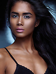 Expressive dramatic beauty portrait of a young beautiful woman with long dark hair