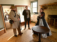 NWA Democrat-Gazette/ANDY SHUPE<br /> Matt Mulheran (left), a park interpreter and Molly Hutchins (right), a living history presenter, speak Friday, Feb. 8, 2019, with park visitor Harrison Hamer of Fayetteville inside the historic Morrow House during a Living History Day at Prairie Grove Battlefield State Park. The day featured living history presenters at several locations around the park as well as a live-fire infantry/musket demonstration.