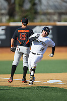 Nate Mondou (10) of the Wake Forest Demon Deacons rounds third base on his way to scoring a run against the Miami Hurricanes at Wake Forest Baseball Park on March 21, 2015 in Winston-Salem, North Carolina.  The Hurricanes defeated the Demon Deacons 12-7.  (Brian Westerholt/Four Seam Images)