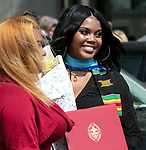 Students celebrate their graduation with family and friends Saturday, June 10, 2017, during the DePaul University College of Education commencement ceremony at the Rosemont Theatre in Rosemont, IL. (DePaul University/Jeff Carrion)