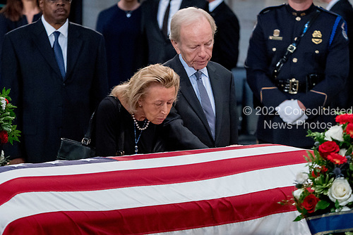 Former Connecticut Sen. Joe Lieberman and his wife Elizabeth Haas stand over the casket of Sen. John McCain, R-Ariz., as he lies in state in the Rotunda of the U.S. Capitol, Friday, Aug. 31, 2018, in Washington. (AP Photo/Andrew Harnik, Pool)