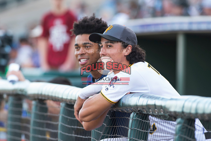 Buddy Reed (85) and Cole Tucker (2), teammates on the AFL West team, in the dugout before the Fall Stars game at Surprise Stadium on November 3, 2018 in Surprise, Arizona. The AFL West defeated the AFL East 7-6 . (Zachary Lucy/Four Seam Images)