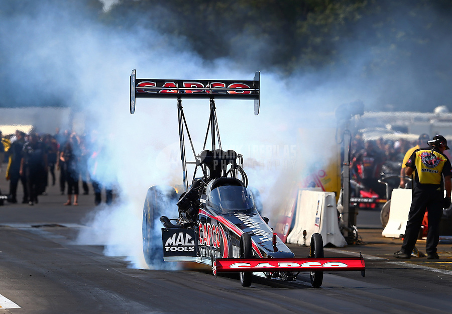 Aug. 17, 2013; Brainerd, MN, USA: NHRA top fuel dragster driver Steve Torrence during qualifying for the Lucas Oil Nationals at Brainerd International Raceway. Mandatory Credit: Mark J. Rebilas-