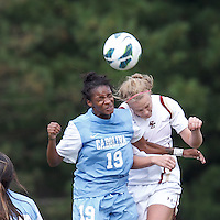 University of North Carolina midfielder Crystal Dunn (19) and Boston College midfielder Jana Jeffrey (12) battle for head ball.   University of North Carolina (blue) defeated Boston College (white), 1-0, at Newton Campus Field, on October 13, 2013.