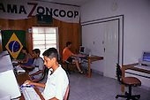 Altamira, Amazon, Brazil. Amazoncoop internet cafe; owned by six Indian tribes; interior with people at computers.
