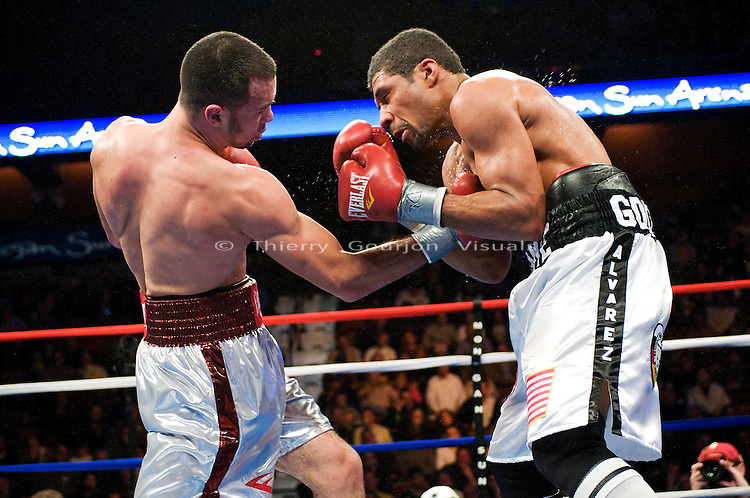 Uncasville, CT - 03.06.2009: Delvin Rodriguez (White/Red trunks) on the attack against Shamone Alvarez (White/Black trunks) during their 12 rounds USBA welterweight title fight at the Mohegan Sun Casino. Rodriguez won a hard fought unanimous decision and kept his title.