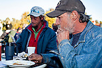"""Jan 10, 2010 - PHOENIX, AZ: RALPH, a homeless man in Phoenix, eats breakfast with his friends at CrossRoads United Methodist Church in Phoenix, AZ. City zoning officials have ordered the church to stop serving breakfast to the homeless and indigent on Saturday mornings. The church started serving breakfast to the homeless in Jan. 2009 and shortly after that neighbors in the upscale area of Phoenix complained to city officials that the church was in violation of zoning ordinances. The city found the church was operating a """"charity kitchen"""" and ordered them to stop serving the breakfast. Rev. Dottie Escobedo-Frank, the pastor of the church, has said the church will file an appeal in US District Court and continue serving the breakfast until the appeals process is exhausted. About 150 people attend the Saturday breakfast each week. Some walk to the church from the alleys they live in in the neighborhood, others are bused to the breakfast by the church, which sens a bus in 1.5 mile radius from the church.         Photo by Jack Kurtz"""