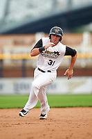Quad Cities River Bandits left fielder Pat Porter (31) running the bases during a game against the Bowling Green Hot Rods on July 24, 2016 at Modern Woodmen Park in Davenport, Iowa.  Quad Cities defeated Bowling Green 6-5.  (Mike Janes/Four Seam Images)