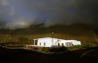 Rainbow over white house, El Hierro, Canary Islands.