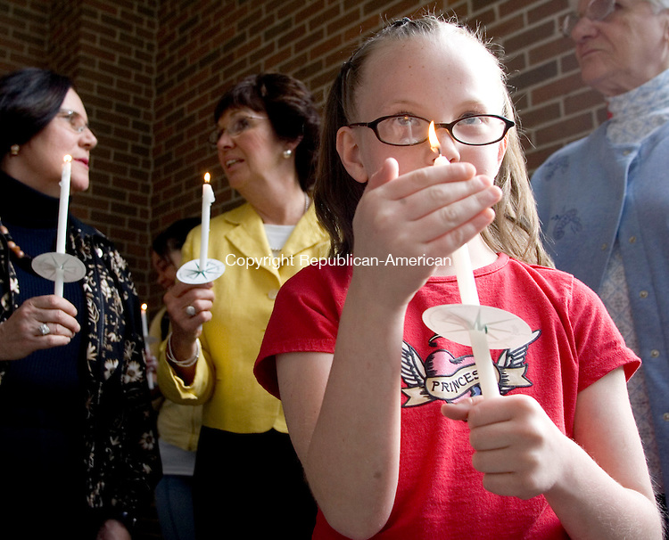 WATERBURY, CT- 30 APRIL 07- 043007JT06-<br /> Andrea Craig, 9, of Waterbury, attends the seventh Shaken Baby Awareness Candlelight Vigil at Naugatuck Valley Community College in Waterbury on Monday, with Virginia O'Rourke of the Exchange Club and Peggy Panagrossi of Safe Haven in the background. The event, which featured Marie Ponzillo and Dr. Stanley Foster of the Young Parent Program at Crosby High School, was sponsored by the Exchange Club of Waterbury.<br /> Josalee Thrift Republican-American
