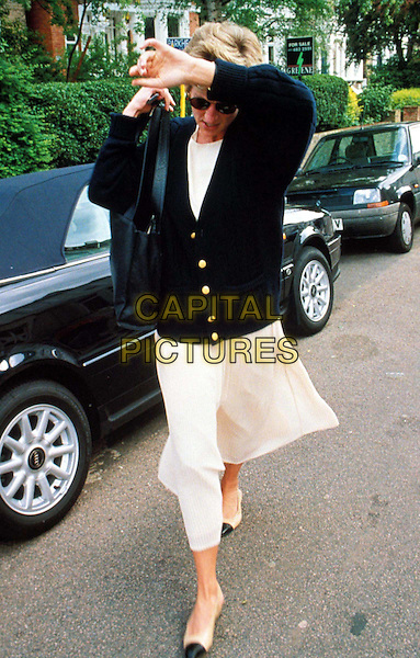 DIANA, PRINCESS OF WALES.Ref: 074.hiding from paparazzi, royalty, white dress, black jacket, cardigan, full length, full-length, dead, deceased.www.capitalpictures.com.sales@capitalpictures.com.©Capital Pictures