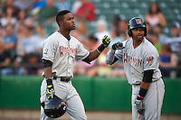Wisconsin Timber Rattlers outfielder Luis Aviles (3) fist bumps Sthervin Matos (9) after hitting a home run during a game against the Peoria Chiefs on August 21, 2015 at Dozer Park in Peoria, Illinois.  Wisconsin defeated Peoria 2-1.  (Mike Janes/Four Seam Images)