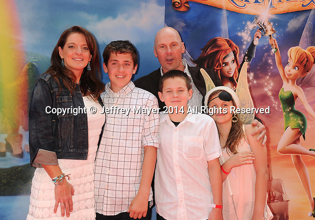 BURBANK, CA- MARCH 22: Producer Jenni Magee-Cook (L) and husband/photographer Stewart Cook (C) and family attend the premiere of DisneyToon Studios' 'The Pirate Fairy' at Walt Disney Studios on March 22, 2014 in Burbank, California.