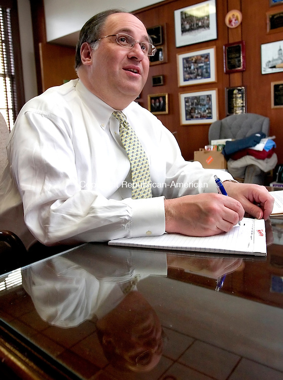 WATERBURY, CT. 24 November 2008-112408SV06--Mayor Michael J. Jarjura writes out a letter on a legal pad in his office Monday in Waterbury. Jarjura doesn't use a computer and his office staff transcribes the letters.<br /> Steven Valenti Republican-American