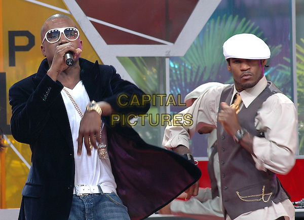 KAYNE WEST . The 4th Annual BET Awards held at The Kodak Theatre in Hollywood, California .June 29,2004.half length, singing, dancing, stage, concert, gig, sunglasses, shades, music.www.capitalpictures.com.sales@capitalpictures.com.Supplied By Debbie Van Story
