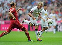 FUSSBALL   1. BUNDESLIGA  SAISON 2011/2012   1. Spieltag   07.08.2011 FC Bayern Muenchen - Borussia Moenchengladbach         Mike Hanke (re, Borussia Moenchengladbach)  gegen Holger Badstuber (FC Bayern Muenchen)