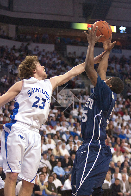 February 24,  2010               Saint Louis guard Kyle Cassity (23) reaches in to try and block the shot by Xavier guard Jordan Crawford (55) in the second half.   The St. Louis University Billikens hosted the Xavier University Musketeers on Wednesday February 24, 2010 at the Chaifetz Arena, located on the campus of St. Louis University near downtown St. Louis.  Xavier ended Saint Louis' six-game winning streak, with a final score of 73-71.