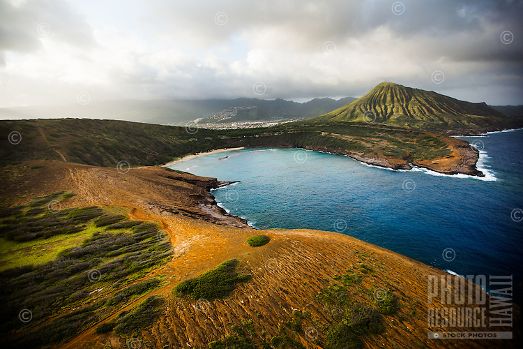 An aerial view of Hanauma Bay before sunset, with Koko Crater in the distance, East O'ahu.