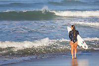 Teen Girl Heading Out to Surf
