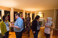 "SEATTLE, WA-APRIL 17, 2017:  Charissa Pomrehn, left, speaks with Nason Fox, Stefanie Fox speaks with Patricia Rangel, and Anjana Agarwal speaks with Amanda Saab, far right, as the dinner party guest prepare to leave. Amanda Saab, along with her husband Hussein Saab, co-hosted a ""dinner with your Muslim neighbor"" at the home of Stefanie and Nason (cq) Fox in Seattle, WA on a return trip April 17th 2017. The couple now live in Detroit. <br /> <br /> (Photo by Meryl Schenker/For The Washington Post)"
