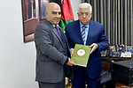 Palestinian President Mahmoud Abbas receives for annual Report of the political steering committee in the West Bank city of Ramallah, on February 28, 2018. Photo by Osama Falah