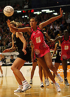 World goalkeep Geva Mentor intercepts a pass to Irene Van Dyk during the International  Netball Series match between the NZ Silver Ferns and World 7 at TSB Bank Arena, Wellington, New Zealand on Monday, 24 August 2009. Photo: Dave Lintott / lintottphoto.co.nz