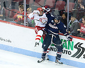 Charlie McAvoy (BU - 7), Jesse Schwartz (UConn - 17) - The Boston University Terriers defeated the visiting University of Connecticut Huskies 4-2 (EN) on Saturday, October 24, 2015, at Agganis Arena in Boston, Massachusetts.