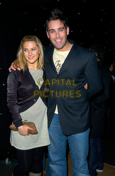 GILES VICKER JONES & GUEST.LG Shine - launch party, Club Cirque, Leicester Square, London, UK..February 7th, 2007.half length black jacket leopard print clutch purse.CAP/CAN.©Can Nguyen/Capital Pictures