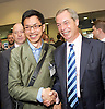 UKIP National Party Conference <br /> Day 2<br /> at Doncaster Race Course, Doncaster, Great Britain <br /> 27th September 2014 <br /> <br /> Nigel Farage <br /> walking through the exhibition area at the Conference <br /> having a photo taken with a delegate <br /> <br /> Photograph by Elliott Franks <br /> Image licensed to Elliott Franks Photography Services