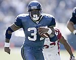 Seattle Seahawks'  running back Shaun Alexander rushes for a touchdown against the Cardinals on Sunday, Sept. 17, 2005 at QWEST Field in Seattle. Jim Bryant Photo. ©2010. All Rights Reserved.