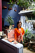 46 year old author, Khoo Salma Nasution poses at her ancestral house in the UNESCO heritage city of Georgetown in Penang, Malaysia. Photo: Sanjit Das/Panos