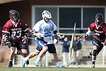 14 February 2015: North Carolina's Evan Connell (99) loses his stick under pressure from UMass's Nick Mariano (23) and Charlie Schatz (right). The University of North Carolina Tar Heels hosted the University of Massachusetts Minutemen in a 2015 NCAA Division I Men's Lacrosse match. UNC won the game 20-8.