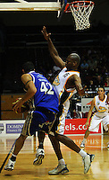 Arthur Trousdell tries to go round Link Abrams..NBL Basketball. Wellington Saints v Devon Dynamos Taranaki, TSB Bank Arena, Wellington. Friday, 11 April 2008. Photo: Dave Lintott / lintottphoto.co.nz