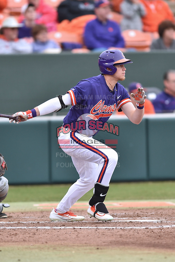 Clemson Tigers right fielder Seth Beer (28) swings at a pitch during a game against the Maine Black Bears at Doug Kingsmore Stadium on February 20, 2016 in Clemson, South Carolina. The Tigers defeated the Black Bears 9-4. (Tony Farlow/Four Seam Images)