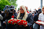 LONDON, ENGLAND, 22 May ,2014.  Julia Stevenson lays a wreath on behalf of bikers at the Lee Rigby memorial outside Woolwich Barracks to mark the first anniversary of the murder of Fusilier Lee Rigby  near his Woolwich barracks.