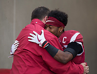 Hawgs Illustrated/BEN GOFF <br /> Bret Bielema, Arkansas head coach, hugs nickel back Kevin Richardson during recognition of senior players before the game against Missouri Friday, Nov. 24, 2017, at Reynolds Razorback Stadium in Fayetteville.