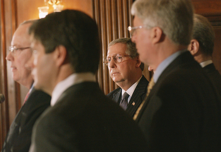 3/21/02.CAMPAIGN FINANCE LEGAL TEAM--Sen. Mitch McConnell, R-Ky., listens as Kenneth Starr, who was independent counsel during Whitewater, currently a partner at Kirkland and Ellis, answers a reporters question during a news briefing unveiling a team of lawyers to challenge the campaign finance reform bill passed yesterday by the Senate, and which President Bush has said he will sign. .CONGRESSIONAL QUARTERLY PHOTO BY SCOTT J. FERRELL