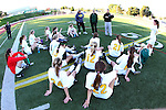 Manhattan Beach, CA 01/21/10 - The Mira Costa girls soccer team look at a 1-0 deficit at half time and coaches provide feedback to the players.