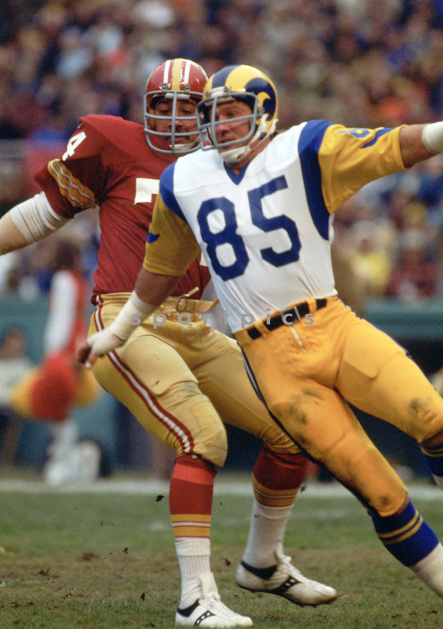 Los Angeles Rams Jack Youngblood (85) during a game from his career with the Los Angeles Rams. Jack Youngblood played for 14 seasons all with Los Angeles Rams, was a 7-time Pro Bowler and was inducted to the Pro Football Hall of Fame in 2001.<br /> (SportPics)