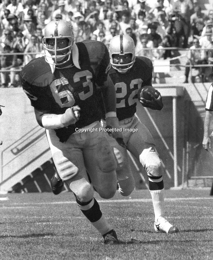 Oakland Raider Larry Todd is led by blocker Gene Upshaw..(1968 photo/Ron Riesterer)