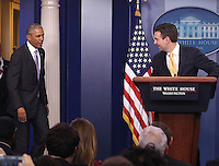 United States President Barack Obama surprises White House Press Secretary Josh Earnest during his last briefing for the administration at the White House, on January 17, 2017 in Washington, DC. On Friday January 20th, President-elect Donald Trump will be sworn in as the nation's 45th president. Photo Credit: Mark Wilson/CNP/AdMedia