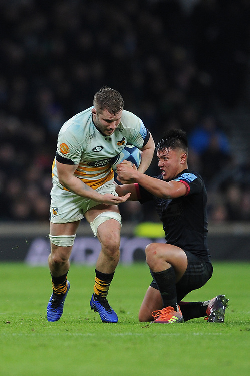 Thomas Young of Wasps tackled by Marcus Smith of Harlequins during Big Game 11, the Gallagher Premiership Rugby match between Harlequins and Wasps, at Twickenham Stadium on Saturday 29th December 2018 (Photo by Rob Munro/Stewart Communications)