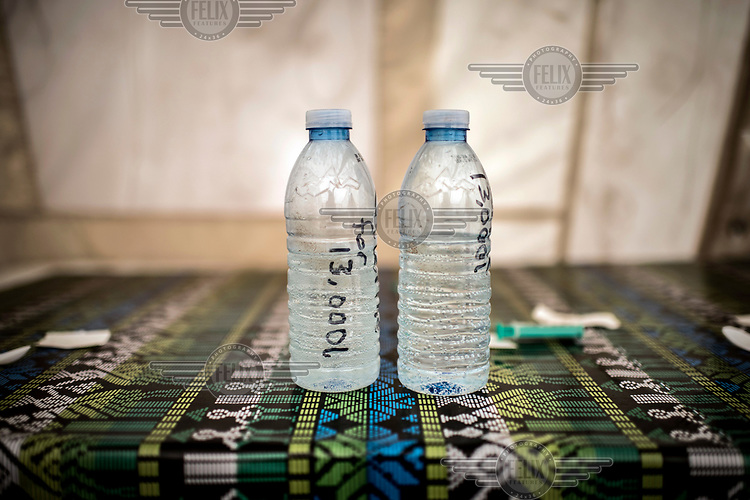 Water samples sit on a table at a Red Cross water treatment plant on the banks of the river Nile.