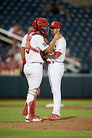 Springfield Cardinals catcher Gabriel Lino (5) talks with relief pitcher Corey Baker (8) on the mound during a game against the Corpus Christi Hooks on May 30, 2017 at Hammons Field in Springfield, Missouri.  Springfield defeated Corpus Christi 4-3.  (Mike Janes/Four Seam Images)